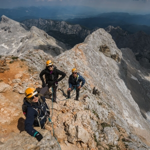 Climbing Triglav in 1 guiding three people to the top