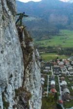Mountain guide showing the view from via ferrata Grančišče above village Mojstrana.