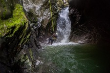 Canyoneer is Enjoying while Rappeling Into the Canyon