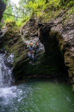 Canyoning Guide Jumping Into Emerald Pool