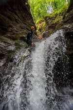 Canyoning Guide at Rappelling into Splashing Water