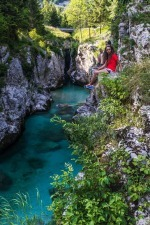 A girl Is Seating above Soča River