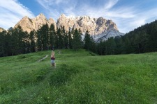 A girl is doing a Handstand at Triglav National Park