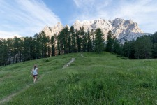 Girl is Walking on the Path towards Julian Alps