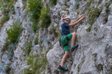 Kids rock climbing near Trigla national Park