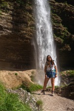 The Girl is Smiling at Pericnik Waterfall