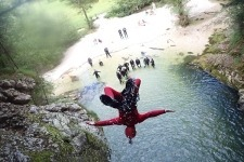 Amazing canyoning Slovenia IFMGA guide backflipping in the pool