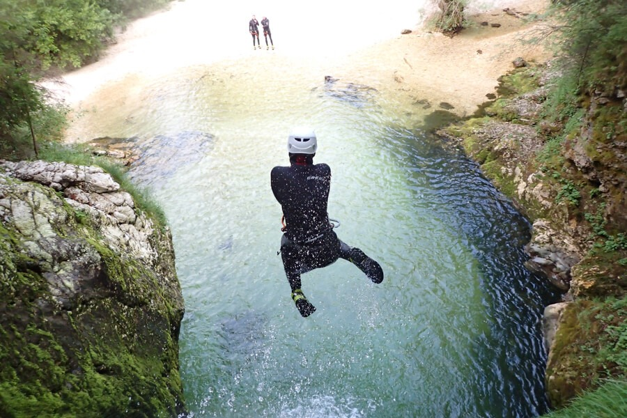 Canyoning Slovenia jump from waterfall Grmečica