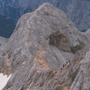 Amazing view from Triglav, people carefully climbing down