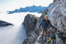 Climbing above clouds in Mojstrovka at the heart of Julian Alps