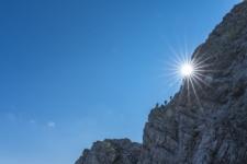 Sun on mountain ridge in Slovenia climbing to the top of Mojstrovka
