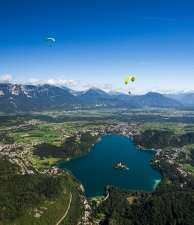 Two Tandem Paragliders Above Lake Bled