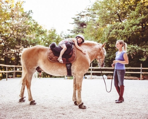 Little Girl Taking Horse Riding Lessons in Slovenia