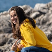 Happy Young Woman in Yellow Hoddie
