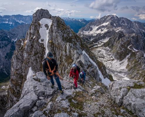 Mountain guide guiding two girls into high mountains