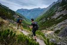 Guys hiking in Kamnik Savinja Alps Mountains