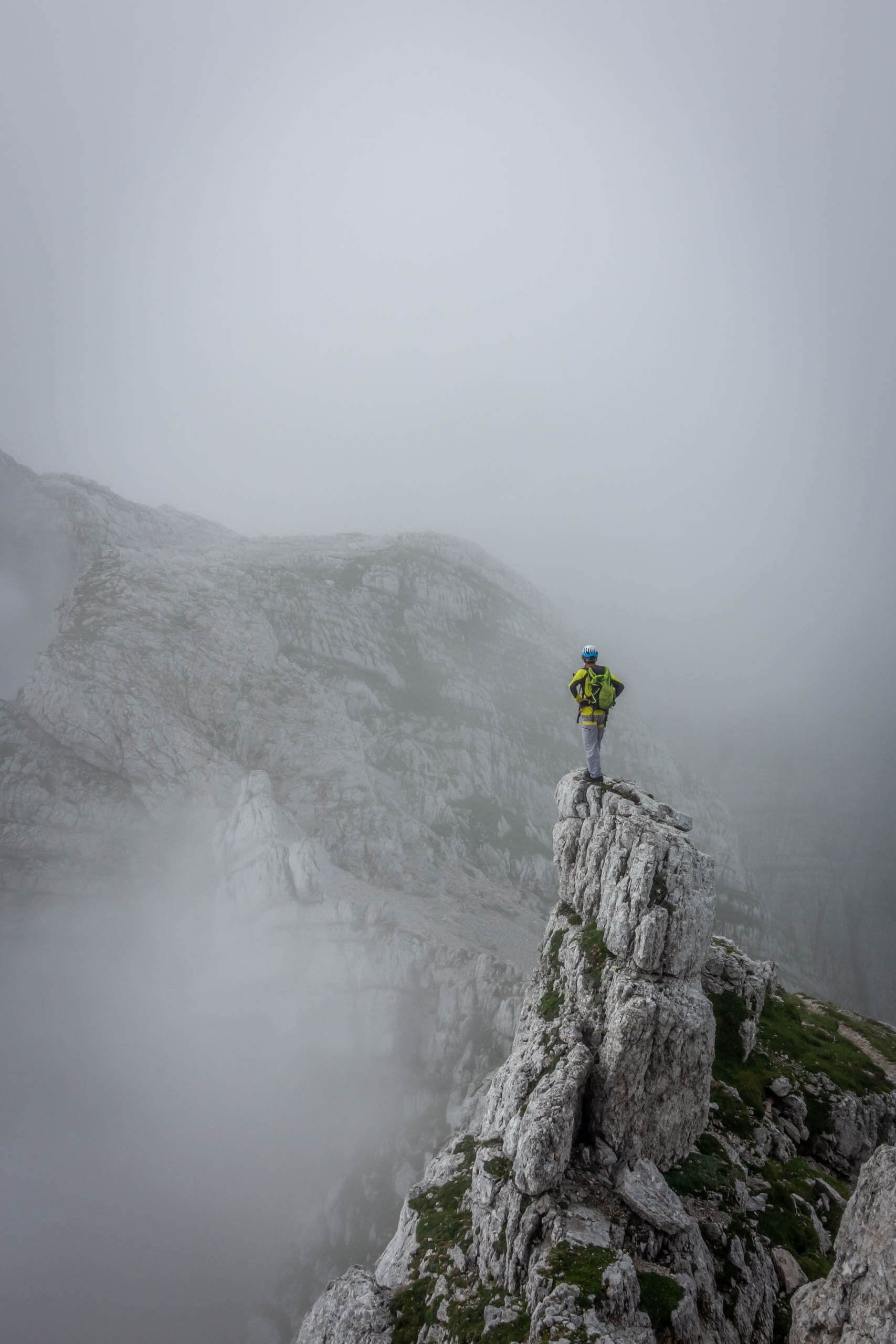 A Hiker in the fog at Plemenice part- Julian Alps