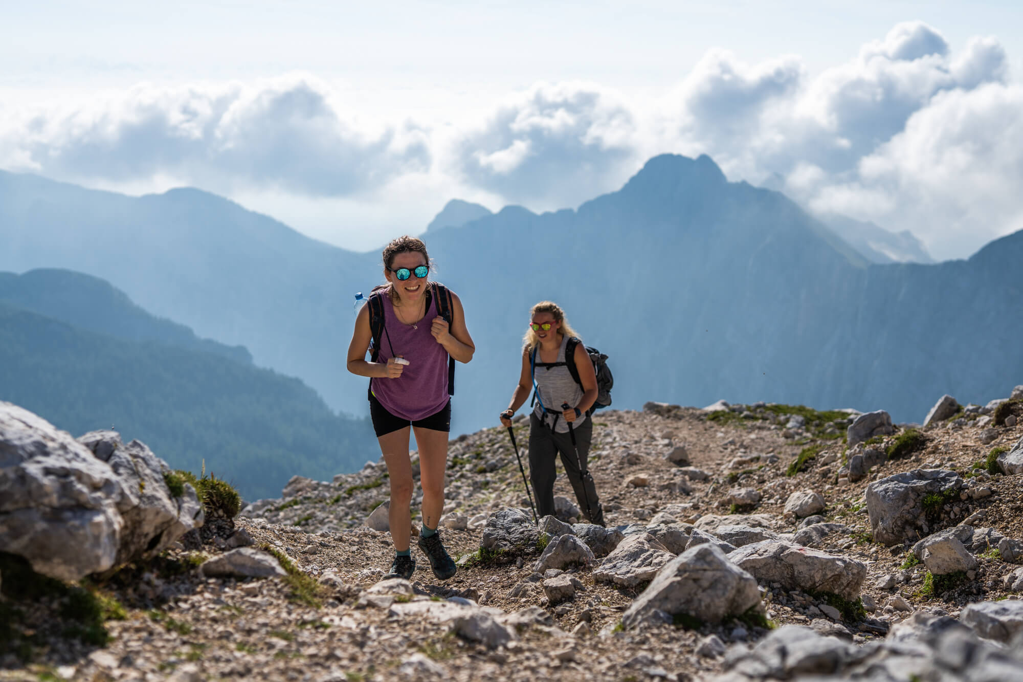 Happy Female Hikers on the Path Towards Kredarica Hut